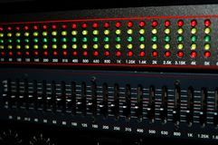Graphic Equalizer. Main board equalizer with levels set and lights dancing.  Main board is to a professional sound board for a rock band Stock Photography