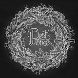 Graphic fir wreath with garlands. Christmas fir wreath with glowing garlands. Vector design elements  on the chalkboard Stock Image