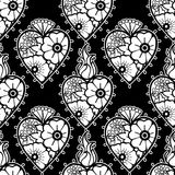 Graphic hearts with floral decorations. Graphic flaming hearts with floral decorations. Inspired by old school tattoo style. Vector seamless pattern. Coloring Stock Photography