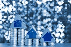 Graphic house icon and Model house wood form with step of coins Royalty Free Stock Images