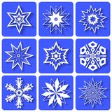 Graphic icons. White snowflakes crystals. Nine snowflakes on a blue background. Theme of winter and New year vector illustration