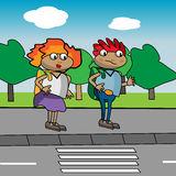 Kids in front of pedestrian crossing Royalty Free Stock Images