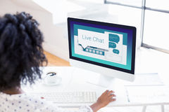 Composite image of graphic image of live chat text with speech bubbles. Graphic image of live chat text with speech bubbles against over the shoulder view of Royalty Free Stock Images