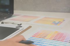Graphic interior designer choosing color from swatch sample catalogue palette guide. artist design & idea for creativity project. Graphic interior designer stock photos
