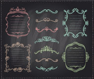 Graphic line dividers, monogram frames and elements set on a chalkboard Stock Photo