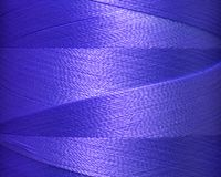 Graphic lines of blue  threads in spool,surface Royalty Free Stock Photo