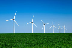 Graphic modern landscape of wind turbines aligned in a  field Stock Photo