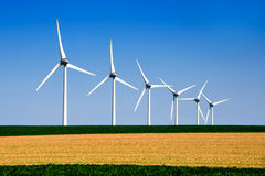 Graphic modern landscape of wind turbines Stock Photos