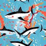Graphic pattern of swimming sharks Stock Photo