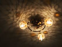 The graphic photo of the chandelier is out of focus, looks like a spaceship stock photo