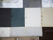 Graphic photo metal wall made of several parts of different color stock photography