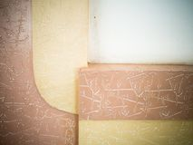 Graphic photo textured wall of yellow, pink and white colors. stock photography