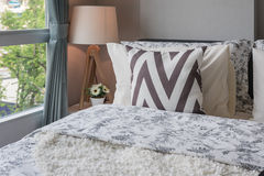 Graphic pillow pattern in bedroom with modern lamp Royalty Free Stock Photography