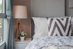 Graphic pillow pattern in bedroom with modern lamp Royalty Free Stock Photos