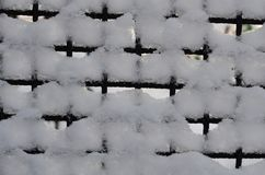 The graphic resource consists of a metal grid covered with snow. The background consists of a metal grid covered with snow royalty free stock images
