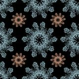 Colorful graphic rose snowflake on a black background. Floral seamless pattern. Graphic rose snowflake   flowers handmade pink blue background seamless pattern Stock Photography