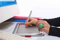 Graphic Tablet. Designer woman working on a graphic tablet. Next to the tablet are the monitor and keypad (White background , shallow focus, copy space for text royalty free stock image