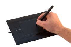 Graphic Tablet. Hand drawing on a graphic tablet isolated over white royalty free stock photo
