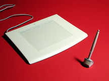 Graphic tablet 2. A graphic tablet with red background stock photography