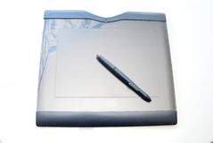Graphic tablet. A blue graphic tablet with electronic pen on white background Stock Image