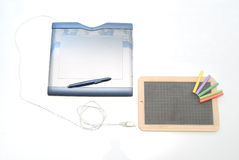 Graphic tablet. A blue graphic tablet with electronic pen on white background Stock Images