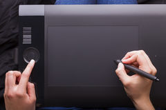 Graphic Tablet Being Used with a Pen Stock Photo