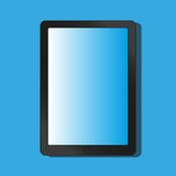 Graphic tablet on a blue background . Royalty Free Stock Photos