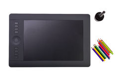 Graphic Tablet and Colorful Pencils on White Background Stock Photos