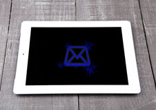 Graphic tablet computer pc gadget letter symbol. Blue on wooden board Stock Photography