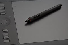 Graphic tablet with digital pen. Royalty Free Stock Photo