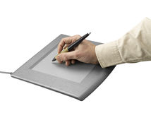 Graphic tablet and hand Royalty Free Stock Image
