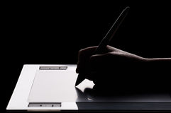 Graphic tablet and hand. Graphic tablet, hand and feather Stock Photos