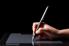 Graphic tablet and hand. Hand of the designer with a pen on a tablet Royalty Free Illustration
