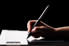 Graphic tablet and hand Royalty Free Stock Photography