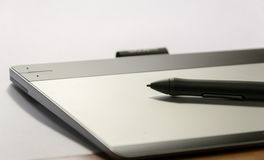 Graphic tablet with his pen tool Royalty Free Stock Images