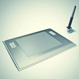 Graphic tablet with pen Stock Photos