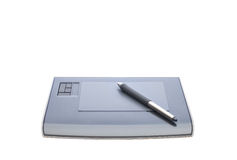 Graphic tablet and pen. A graphic tablet with pen isolated on white background Stock Photography