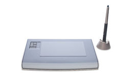 Graphic tablet and pen. A graphic tablet with pen isolated on white background Stock Photo