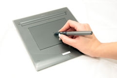 Graphic tablet, pen and designer hand Stock Images