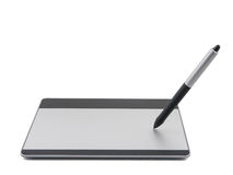 Graphic tablet with pen drawing Royalty Free Stock Photo