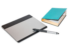Graphic tablet with pen and notebook Stock Photo