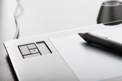 Graphic Tablet. With pen on table Royalty Free Stock Image