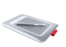 Graphic tablet with pen on white background. Stock Image