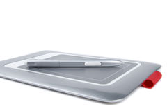 Graphic tablet with pen on white background. Stock Photography