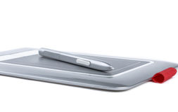 Graphic tablet with pen on white background. Stock Photo