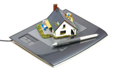 Graphic tablet and plastic house Stock Images