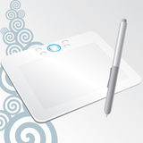 Graphic tablet with a stylus pen. White graphic tablet with a stylus pen to draw on the computer on a gray background with swirls Royalty Free Stock Photo