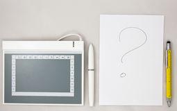 Graphic tablet vs traditional paper with pen Royalty Free Stock Photo
