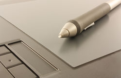 Graphic tablet4. Graphic tablet with a feather Royalty Free Stock Photo