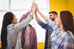 Graphic team giving high-five Royalty Free Stock Photography